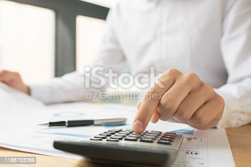 941729686istockphoto Business accounting concept, Business man using calculator 1188733269