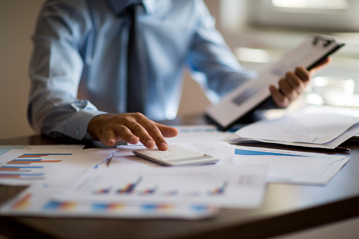 istock Business accounting concept, Business man using calculator with computer laptop, budget and loan paper in office. 1178916772