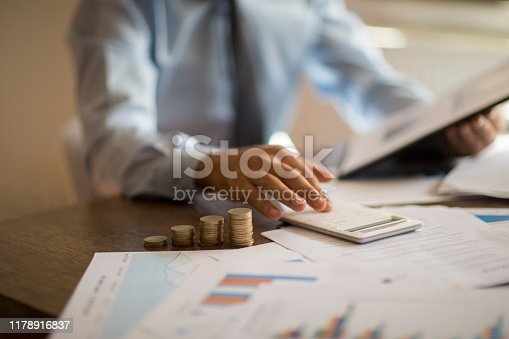 941729686 istock photo Business accounting concept, Business man using calculator with computer laptop, budget and loan paper in office. 1178916837