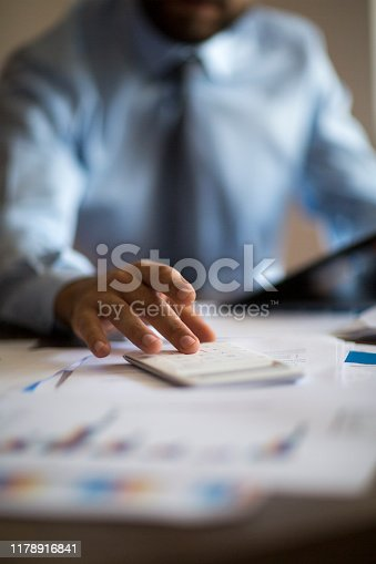 941729686 istock photo Business accounting concept, Business man using calculator with computer laptop, budget and loan paper in office. 1178916841