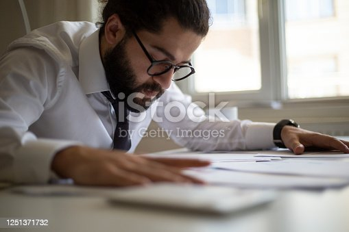 941729686 istock photo Business accounting concept, Business man using calculator with computer laptop, budget and loan paper in office. 1251371732