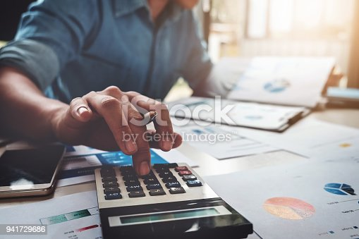 istock Business accounting concept, Business man using calculator with computer laptop, budget and loan paper in office. 941729686