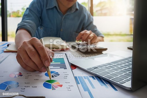 941729686 istock photo Business accounting concept, Business man using calculator with computer laptop, budget and loan paper in office. 948340038