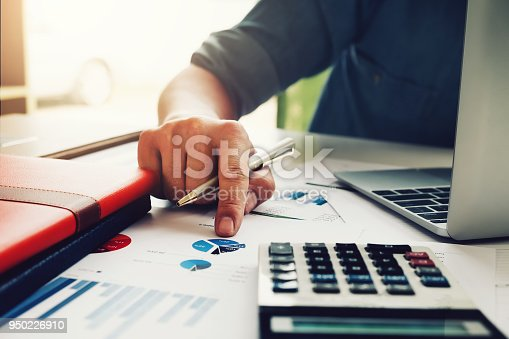 941729686 istock photo Business accounting concept, Business man using calculator with computer laptop, budget and loan paper in office. 950226910