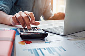 istock Business accounting concept, Business man using calculator with computer laptop, budget and loan paper in office. 953533708