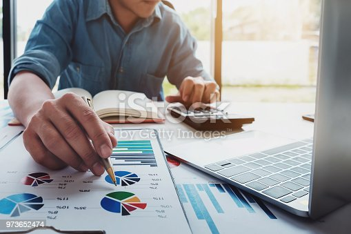 941729686 istock photo Business accounting concept, Business man using calculator with computer laptop, budget and loan paper in office. 973652474