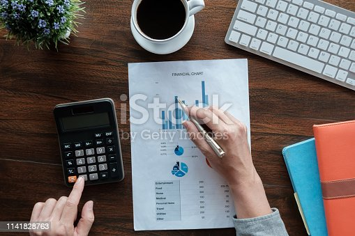istock Business accounting concept, Business man using pen pointing  with stock market data financial chart and calculator for calculate finance plan  paper in office. 1141828763
