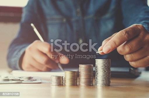 istock business accounting with saving money with hand putting coins on stack concept financial 820810158