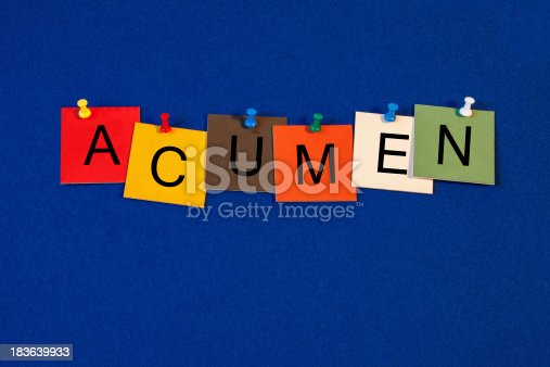 Business Acumen - sign - letters and tiles on noticeboard with pins
