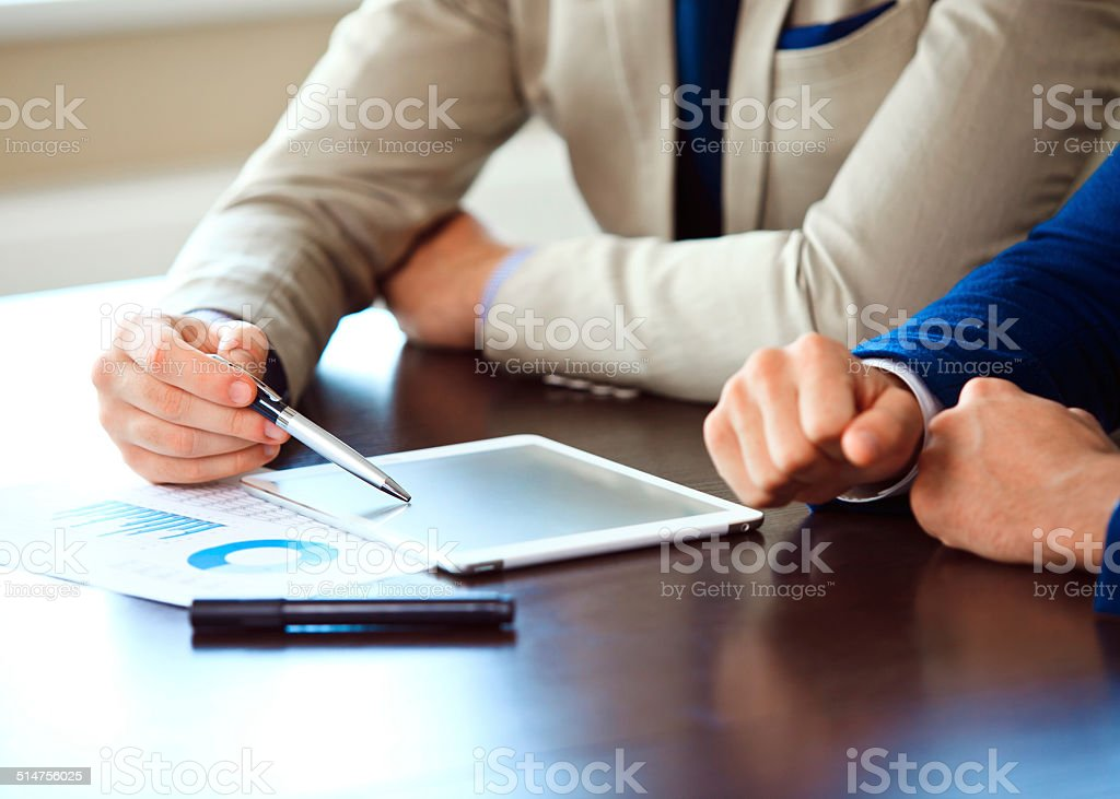 Business adviser analyzing financial figures stock photo