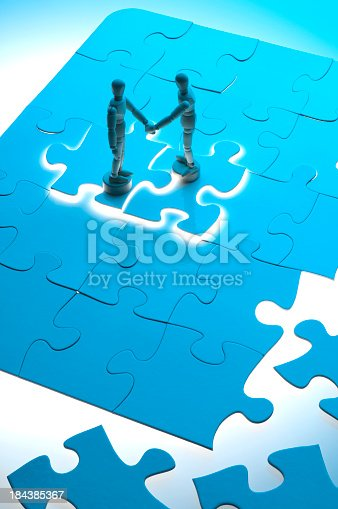 istock Business agreement concept with wooden figures 184385367