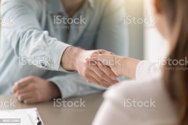Business Agreement Handshake Of Man And Woman At The Office Stock Photo - Download Image Now