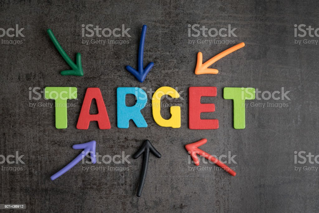 business aiming target plan for success concept multi colorful magnet arrows pointing at wooden letters