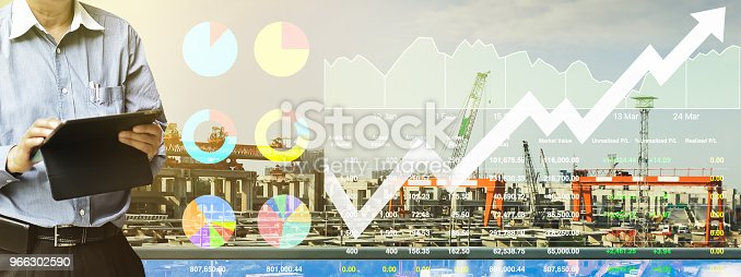 istock Business analysis presentation data of stock index market in industrial and construction sector shown graph and chart on construction background. 966302590