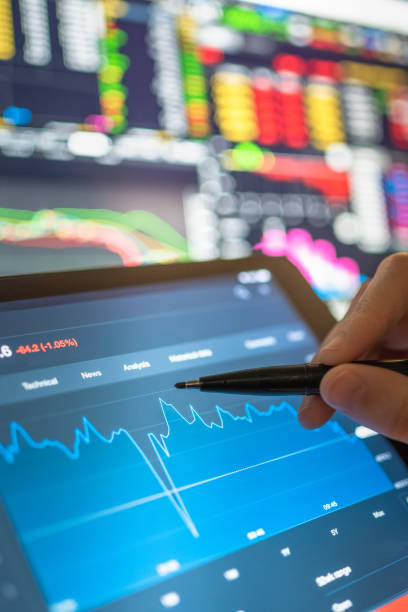 Business analysis stock chart in crisis for investment in stockmarket and finance business planning selective stock for Stockmarket crash and Financial crisis stock photo