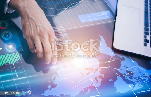 960164282istockphoto Business analyst is reading fresh financial report on a screen of modern hi tech digital tablet. Male hands with futuristic gadget 1151399368