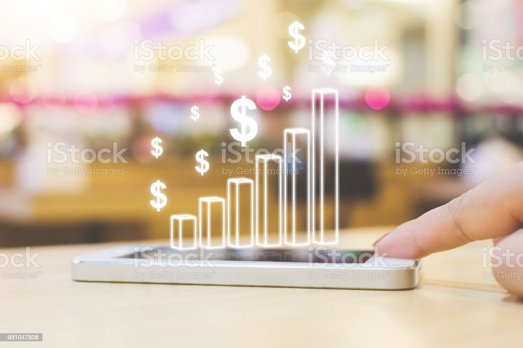 Business analytics and online financial technology (fintech) concept. Hand of female pushing smartphone device stock photo