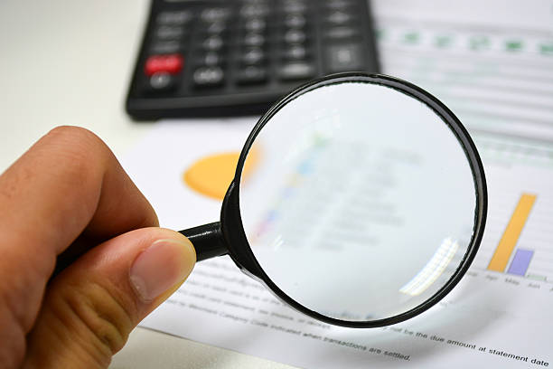 Business analytics. Calculator, financial reports Business analytics. Calculator, financial reports low scale magnification stock pictures, royalty-free photos & images