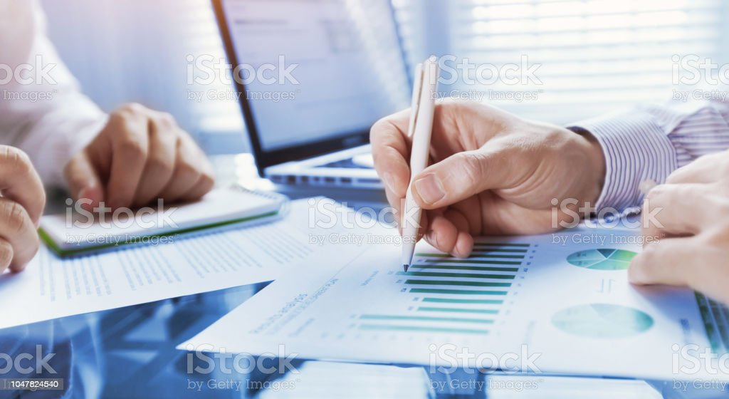 business analytics, team of people working on financial report in the office, teamwork stock photo