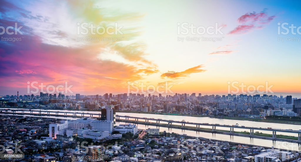 Business and culture concept - panoramic modern city skyline bird eye aerial view with Mountain Fuji under dramatic sunset glow and beautiful cloudy sky in Tokyo, Japan stock photo