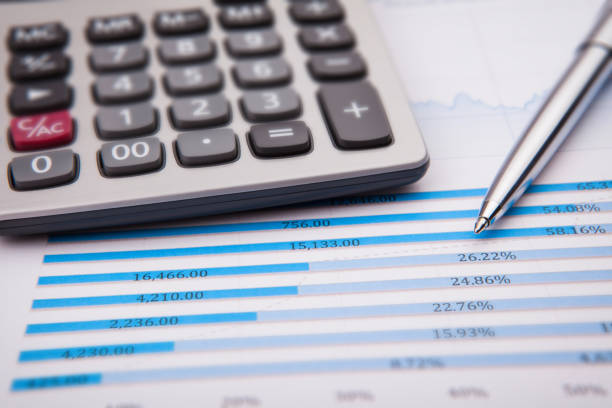 Business and Finance Concept: Analyzing Financial Report stock photo