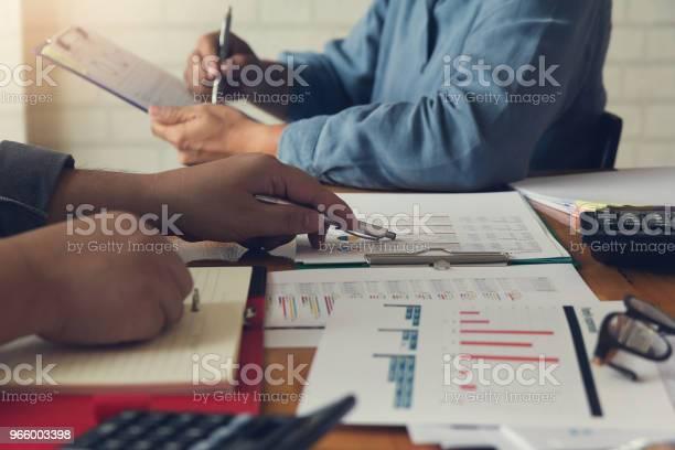 Business And Finance Concept Of Office Working Businessman Using Calculator To Discussing Sale Analysis Chart - Fotografias de stock e mais imagens de Acessório Financeiro