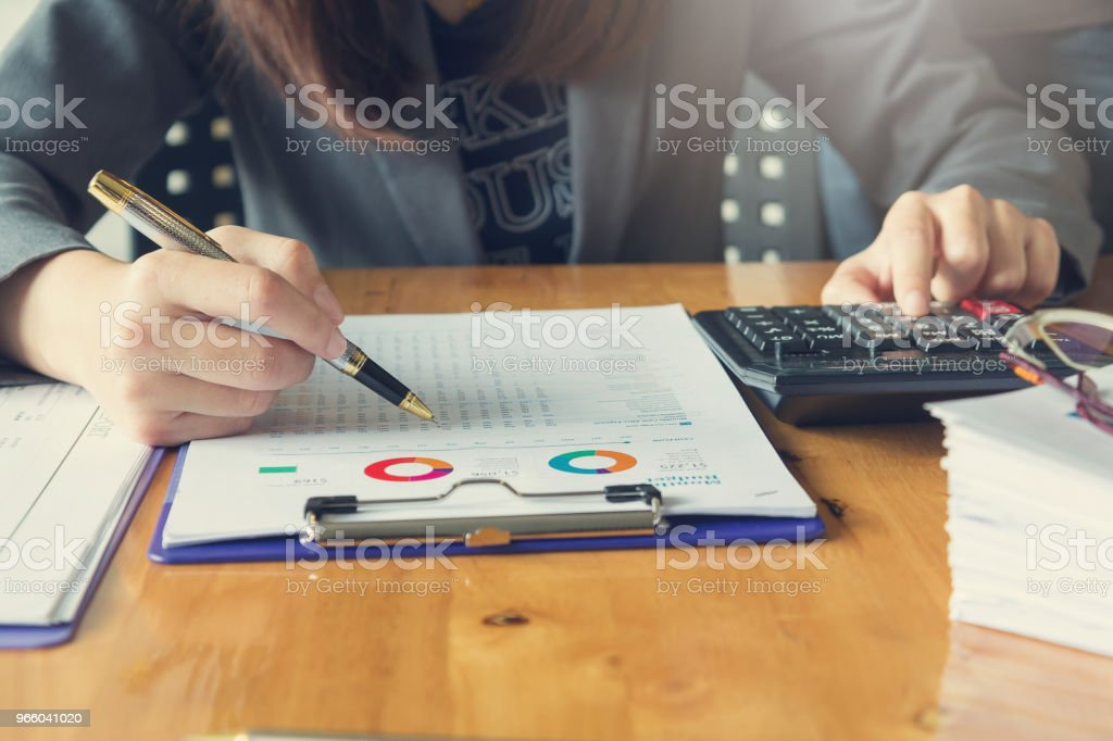 Business and finance concept of office working, Businessman using calculator to discussing sale analysis Chart - Royalty-free Accountancy Stock Photo