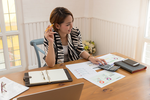 Business And Finance Concept Of Office Working Businesswoman Discussing Sale Analysis Chart Stock Photo - Download Image Now