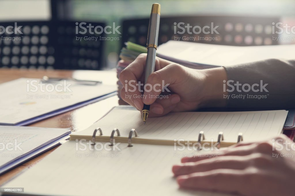 Business and finance concept of office working, Businesswoman writing on notebook - Стоковые фото Анализировать роялти-фри