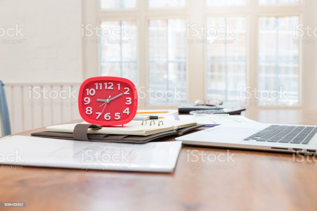 Business and finance concept of office working,Closeup Clock on office desk stock photo