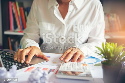 Business and finance planning concept.Financial adviser planning and working on laptop,Professional businesswoman discuss and review annual report at office.