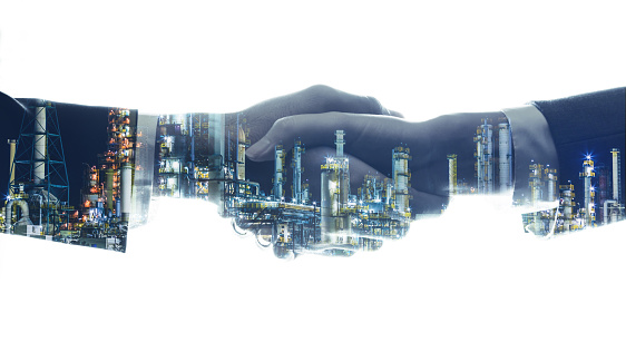 istock business and industry concept. businessperson shaking hands and modern factory image. mixed media. 861132302