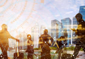 istock Business and modern technology concept. Double exposure of silhouetted people in city with wireless connection icons. Global communication. 1084390952