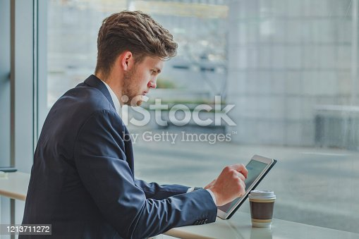 879878976 istock photo business and technology, banking online, businessman using gadget digital tablet 1213711272