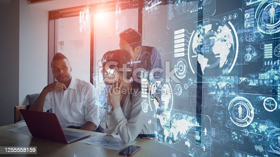 Business and technology concept. Smart office. GUI (Graphical User Interface). Group of businessperson in the office.