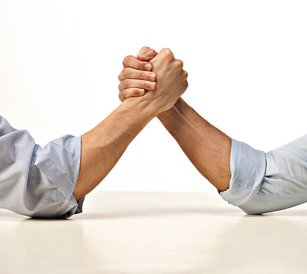 business arm wrestling stock photo