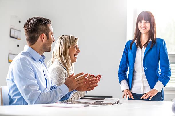 Business associates applauding female colleague in board room – Foto