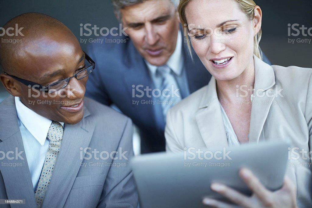Business associates working on project using tablet PC royalty-free stock photo