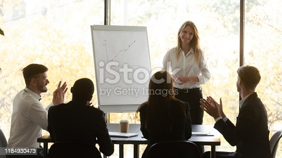 924519152 istock photo Business audience applaud happy female presenter thank for conference seminar 1184930473