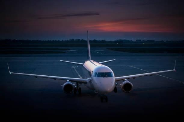 Business aviation flight in twilight. stock photo