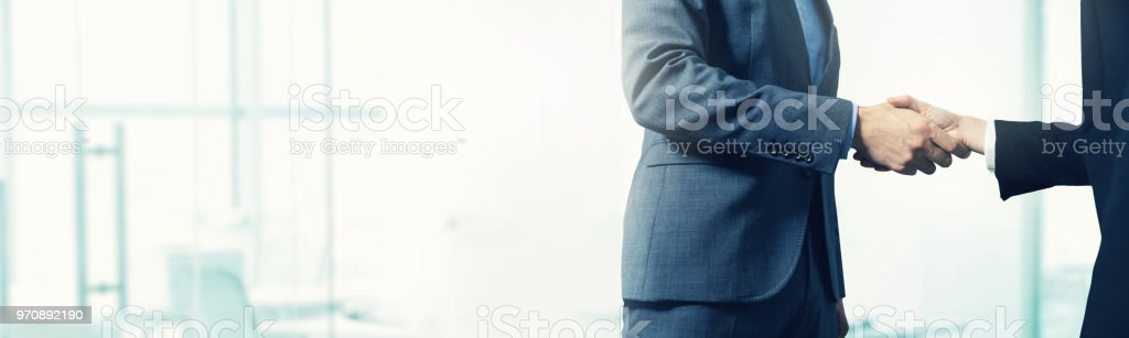 business background - businessmen handshake with copy space stock photo