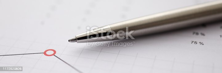 istock Business background chart with silver pen lie 1172520826