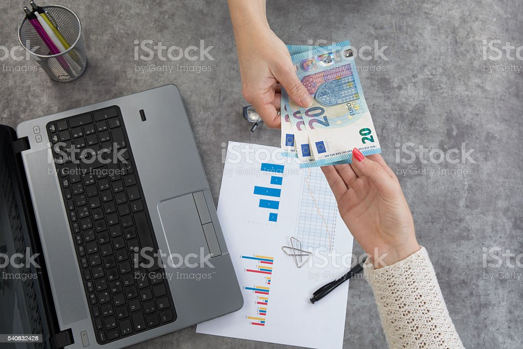 Business background laptop, notebook and pen, bills. stock photo