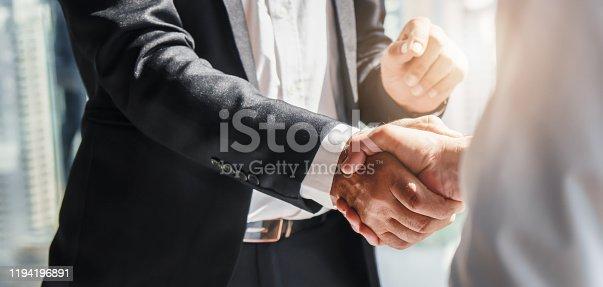 istock business background of businessman having handshake 1194196891