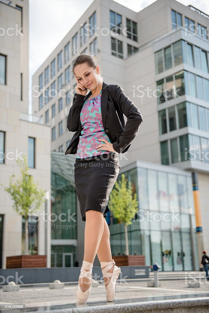 Business ballet dancer on the phone stock photo