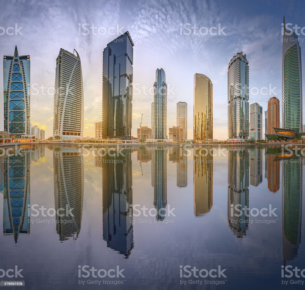 Business bay and Lake Tower, reflection in a river stock photo