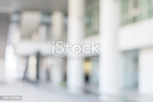 1009742300 istock photo Business blur background office lobby hall interior white room with blurry light from corridor glass wall 1021402930
