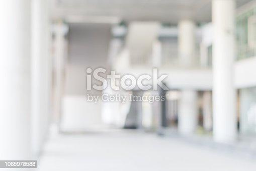 1009742300 istock photo Business blur background office lobby hall interior white room with blurry light from corridor glass wall 1065978588