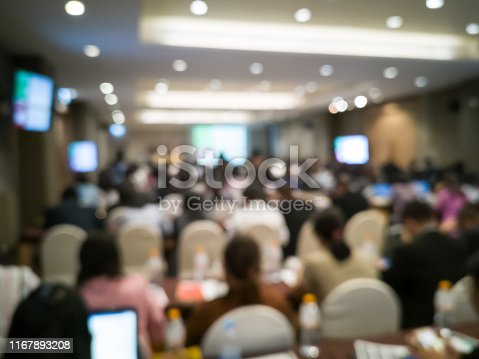 istock Business blurred background. People in seminar hall. Event of business group. 1167893208