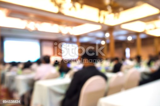 istock Business blurred background. Seminar and conference in convention hall. 694538834